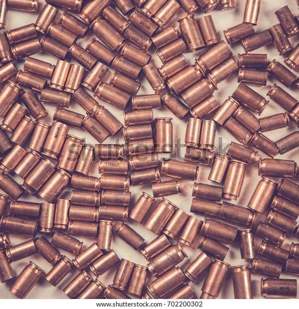Bullets and shells pistol handgun background on white background