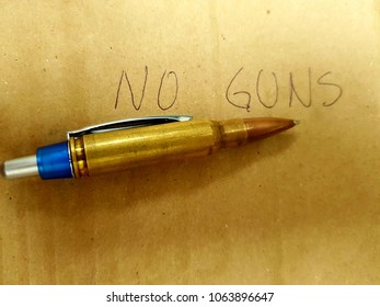 Bullet-shaped pen, with the phrase no more guns.