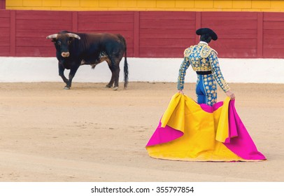 A bullfighter awaiting for the bull in the bullring. Corrida de toros