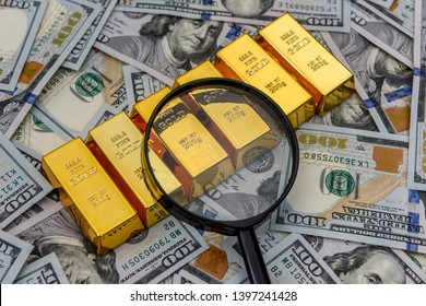 Bullion, gold or ingot on US dollar banknote with magnifier