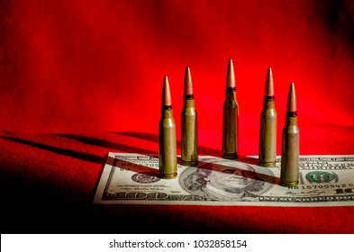Bulls in dollars and black-and-black background as an abstract symbol of the causes of military conflicts in the world and tragedies and murders
