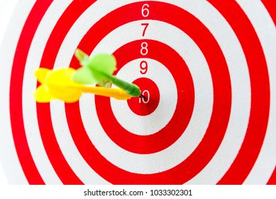 Bullseye is a target of business, dart is an opportunity and dartboard is the target and goal, a challenge in business marketing success concept.