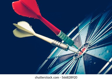 Bullseye is a target of business. Dart is an opportunity and Dartboard is the target and goal. So both of that represent a challenge in business marketing as concept.