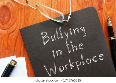 Bullying in the Workplace is shown on the conceptual business photo