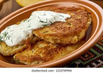 Bulviniai Blynai, Potato pancake,  Lithuanian  cuisine, Baltic Traditional assorted dishes, Top view.