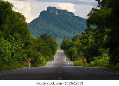 Bumpy asphalt road on hill in Lampang Thailand