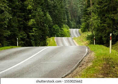 Bumpy curvy road surrounded by Labanoras forest in Lithuania