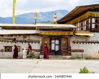 Bumthang, Bhutan - May 12 2019: Monks circling Tamzhing Monastery in Bumthang district