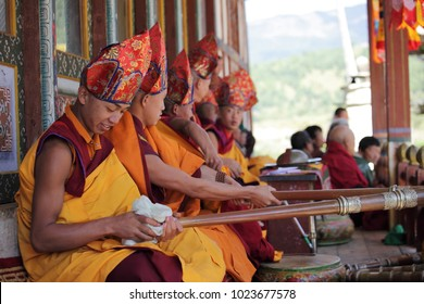 BUMTHANG, BHUTAN - OCTOBER 6, 2011: Buddhist monks getting ready to play horns before the festive cermony in Bhutan.