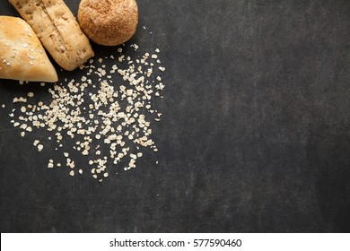 Bun of bread with oat flakes, healthy meal for people on non gluten diet, free space for typing text.