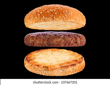 Bun and veal patty ingredient hamburger isolated on black background