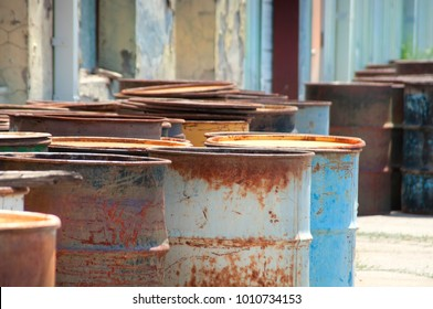 A bunch of 55 gallon drums on a loading dock.