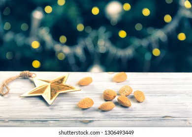 A bunch of almonds with a beautiful bokeh on the wooden able