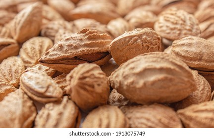 A bunch of almonds close-up. Salted fresh nuts in the shell. The texture of the almonds.