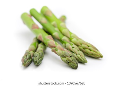 Bunch of asparagus on white background.
