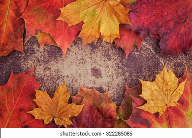 A bunch of autumn leaves on a shabby chic surface