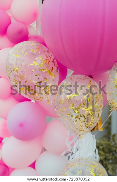 A bunch of balloons on a birthday party