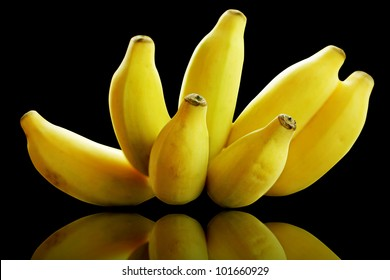 Bunch of banana fruits ripe isolated on black with clipping mask