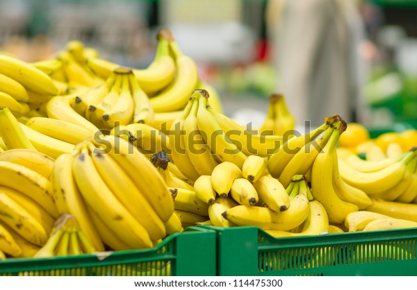 Bunch of bananas in boxes in supermarket
