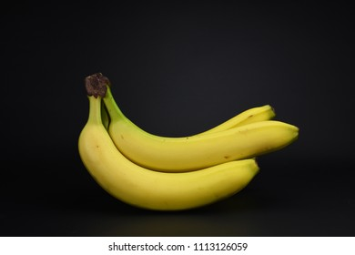 Bunch of bananas isolated on black background