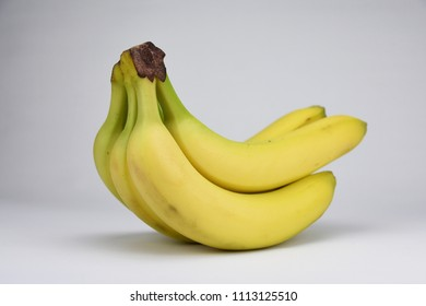 Bunch bananas isolated on grey white background