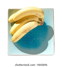 bunch of bananas on a blue square plate,