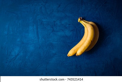 bunch of bananas on a dark blue background