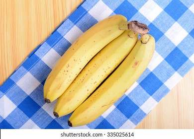 Bunch of bananas on white bowl, health food concept