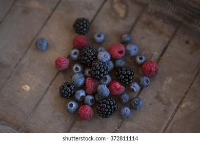 bunch of berries in a wooden basket