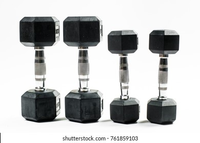 Bunch of black dumbbells isolated on white. Training weights.