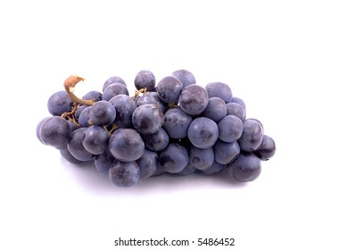 a bunch of blue grapes on white