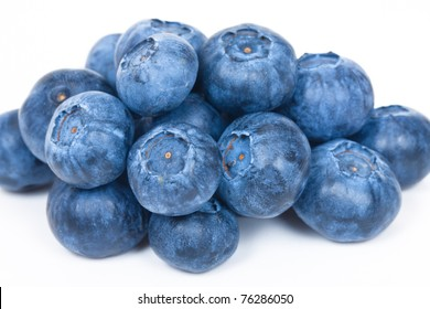 Bunch of blueberries isolated on white background. Ripe blueberries for food pack.