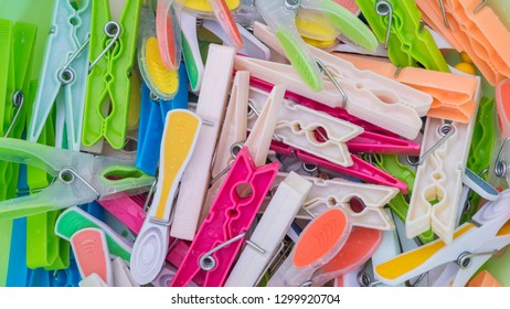 Bunch of bright colorful clothespins, close up