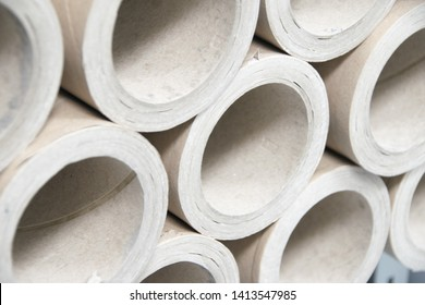 A bunch of brown industrial paper core. A lot of paper cores or paper tubes. Brown paper rolls. - Image