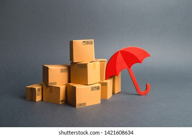 A bunch of cardboard boxes and a red umbrella. concept of purchases. Providing warranty on purchased products. Consumer rights Protection. Support of the national manufacturer by government