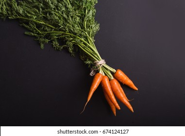 A bunch of carrot on a black background