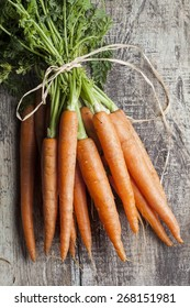Bunch of carrot on a wooden background