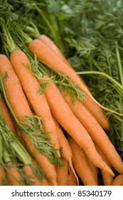 Bunch of carrots on a market stool