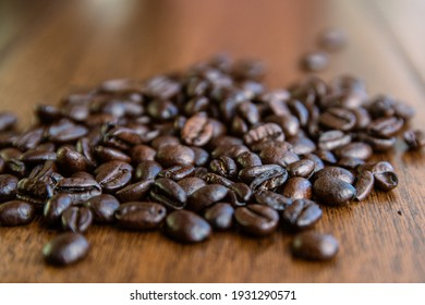 A bunch of Coffee Beans on a wodden Table