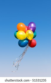 Bunch of colorful balloons in the blue sky