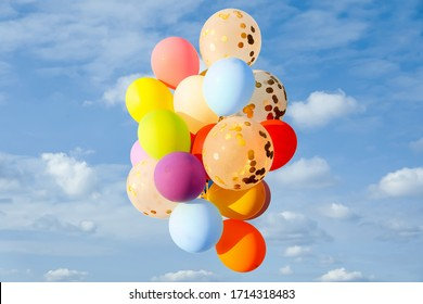 Bunch of colorful balloons outdoors on sunny day