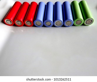 a bunch of colorful high capacity rechargeable batteries side by side isolated in a white background
