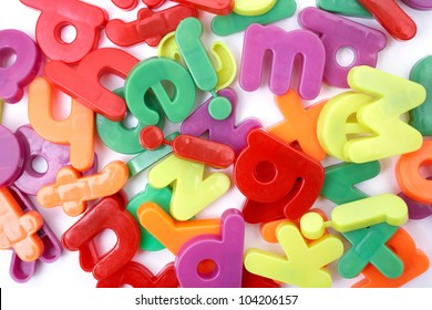 Bunch of colorful magnetic letters on a light background