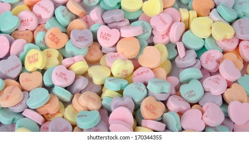 A bunch of colorful Valentine's candy hearts.