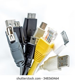 Bunch of computer cables with sockets isolated on a white background. USB cables. LAN cable