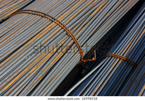 Bunch of concrete reinforcement steel rods in warehouse