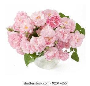 Bunch of cream roses in vase isolated on white