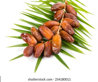 bunch of date fruits with palm leaf  isolated on white background