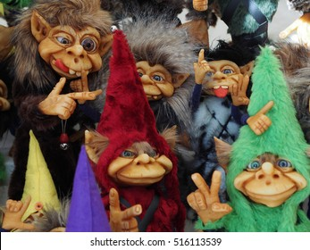 A bunch of different colorful little cute trolls