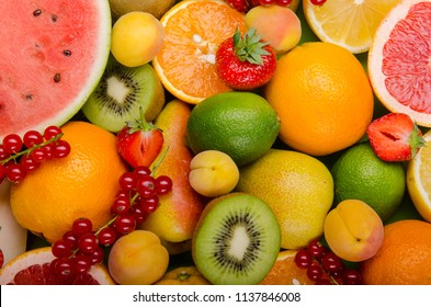 a bunch of different colourfull exotic fruits